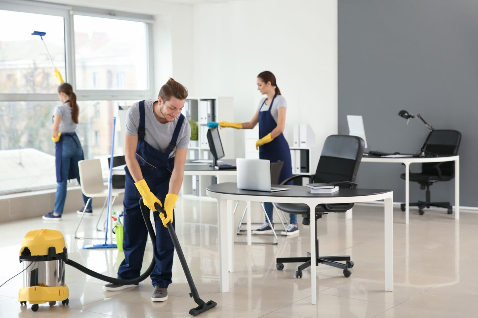 Team of cleaners in commercial office building